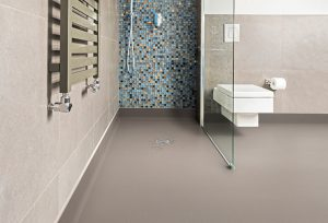 Modern and grey bathroom with shiny tiles and white lavatory