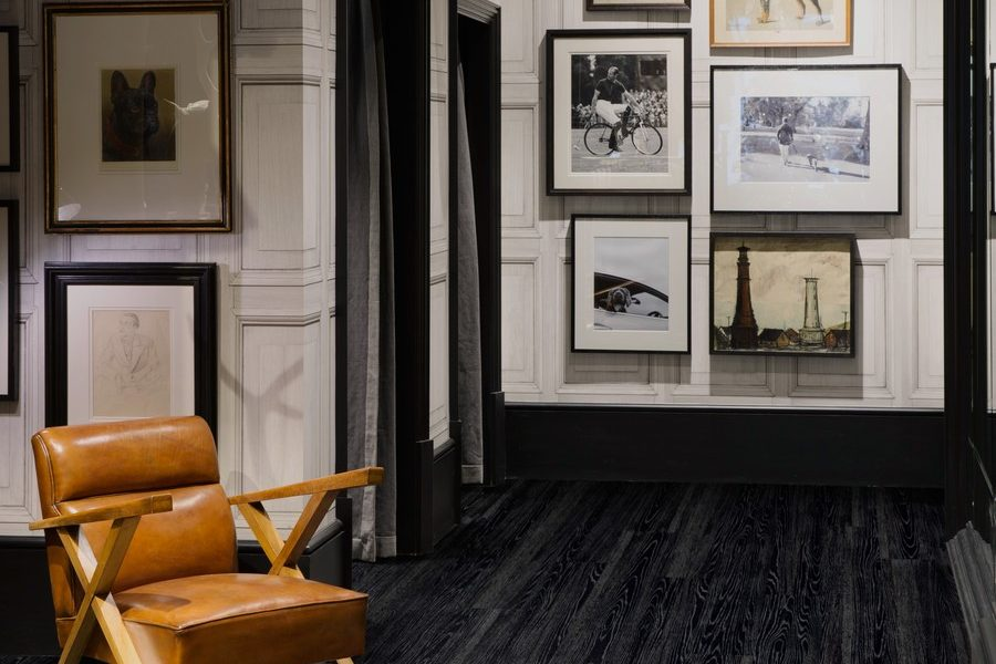 Hackett London, Oxford Street, London, United Kingdom. Architect: Hackett In-House, 2013. Seating corner with picture wall.